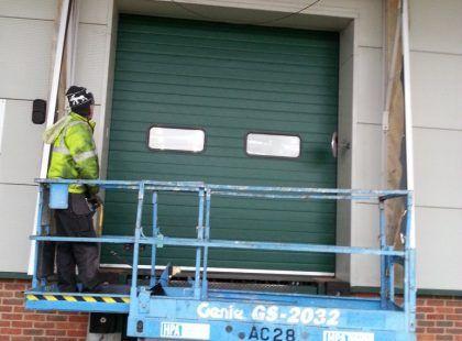 green industrial door with windows