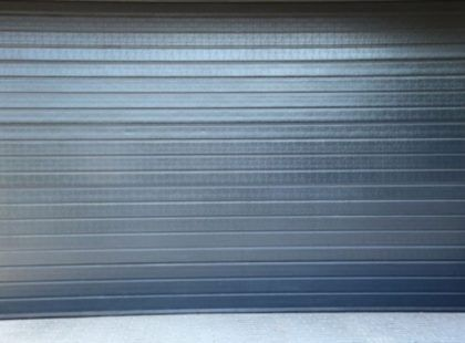 dark blue roller shutter door
