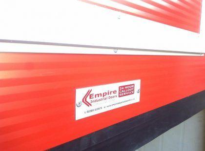 empire industrial door sticker on red door