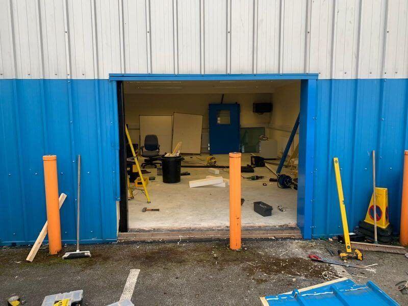 Our team repairing a set of industrial doors.